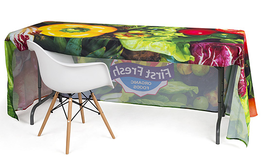 Custom-printed table covers with open backs allow room to pull up chairs