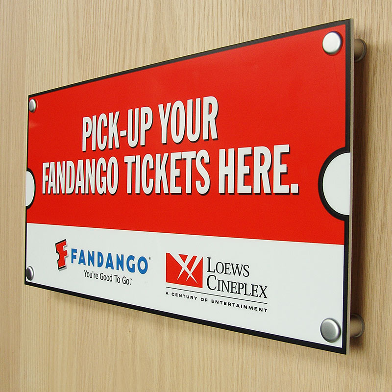 Wall mounted sign with tamperproof standoffs