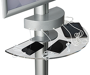 Closeup of a charging station with plugged-in cell phones.