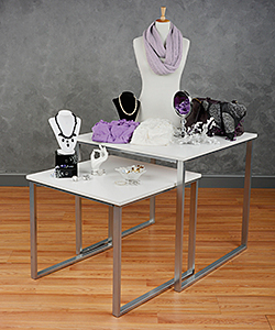 Retail nesting tables displaying products for sale