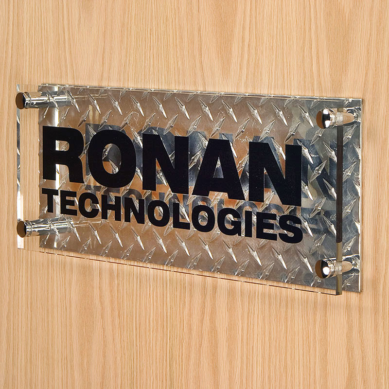 This dual-layer sign features a diamond plate backer