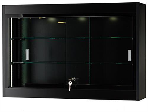 This Display Cabinet Features a Curved Black Metal Frame for a Modern Looking Wall Display! This ...