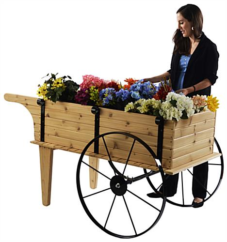 Outdoor flower wagon wheeled red cedar display fixture for Carros de madera para jardin