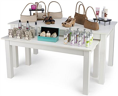 Large Nesting Table Promoting a Variety of Merchandise