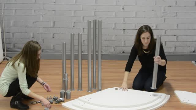 <p>Check out how this rotating retail display table morphs from one configuration to another.  Assembly is easy with 2 people, just watch and see for yourself! </p>