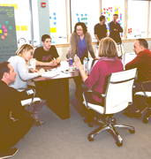 displays2go employees undergoing design thinking traning