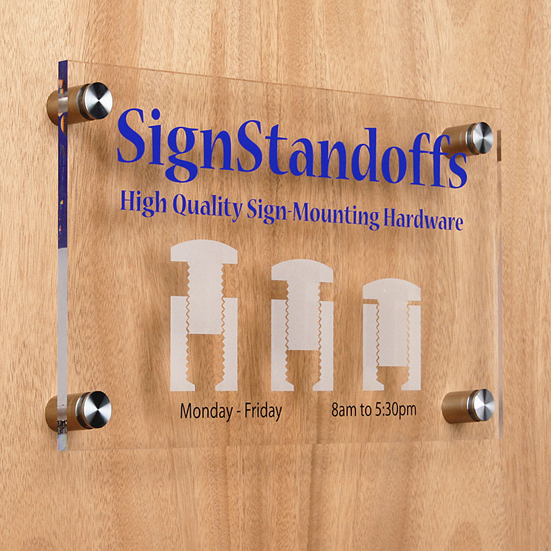 Wall mounted sign panel with stainless steel standoffs