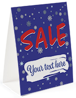 Paper holiday advertising table tent with blue snowflake theme