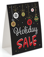 Seasonal tabletop promo sign with festive advertising message